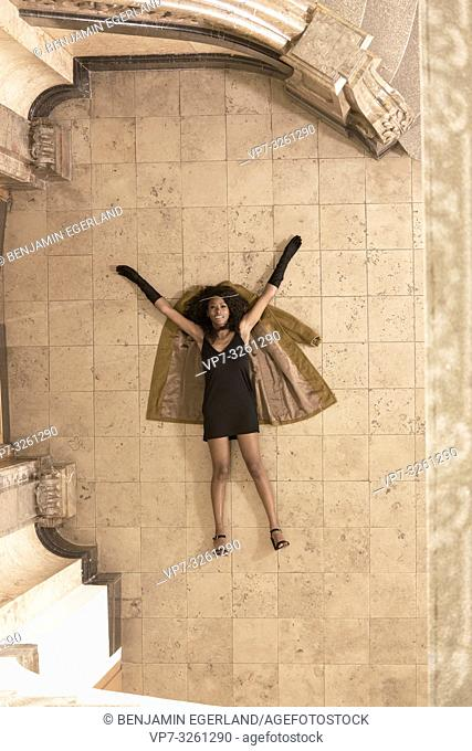 woman laying on the floor, in Munich, Germany