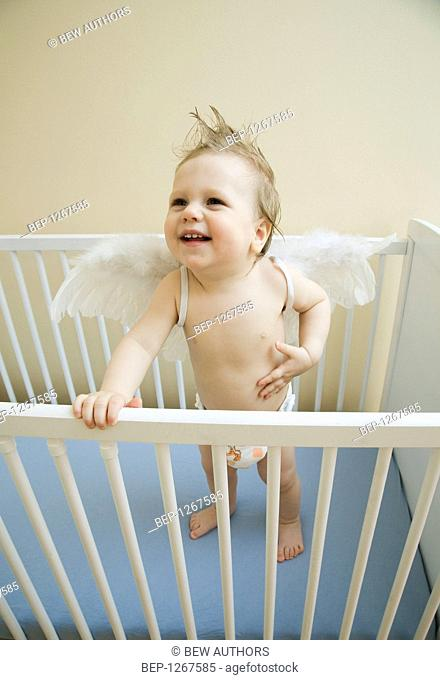 Baby boy in the cot
