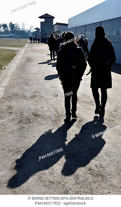 Visitors walking through the former Sachsenhausen concentration camp in Oranienburg, Germany, 1 March 2016. More than 660