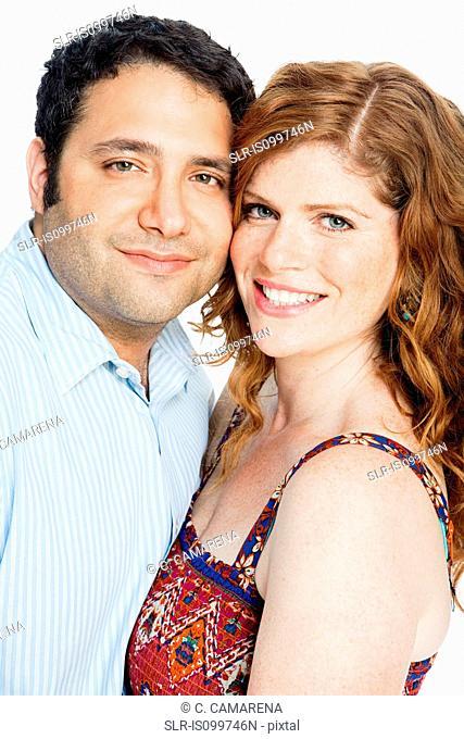 Couple smiling against white background