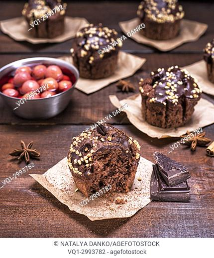 chocolate muffins on a brown wooden background, close up, vintage toning