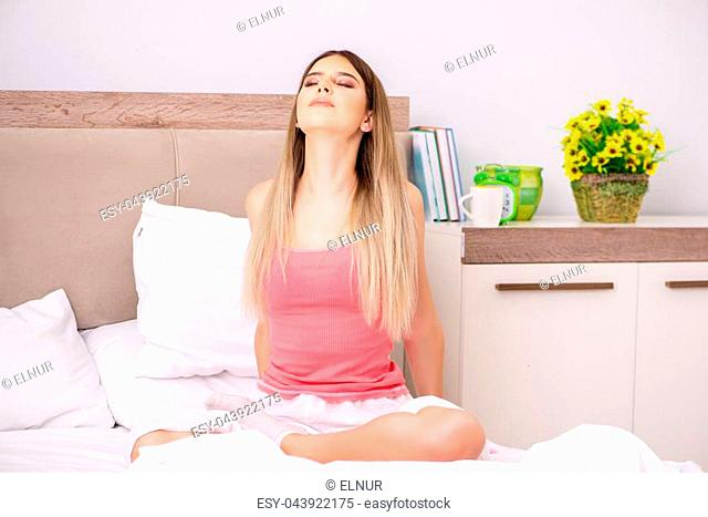 Young woman waking in the morning