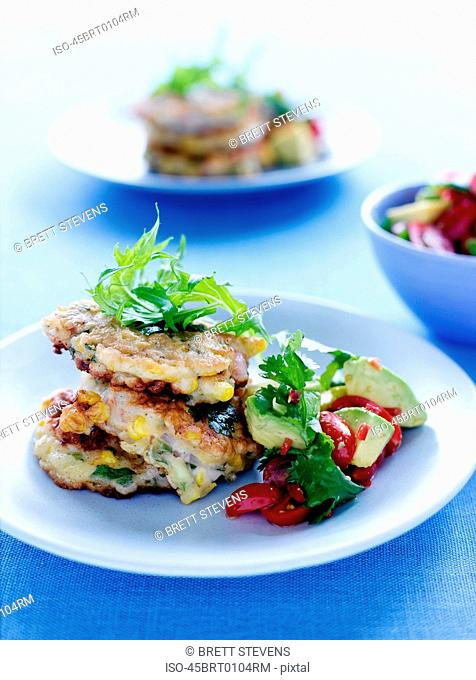 Plate of fried cakes with salad