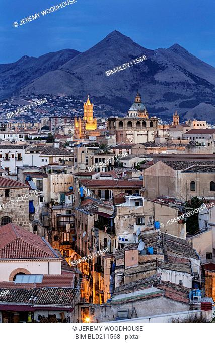 City below mountains at dusk, Palermo, Sicily, Italy