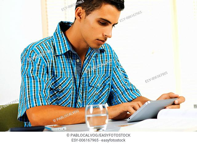 Young man using a tablet PC in an office