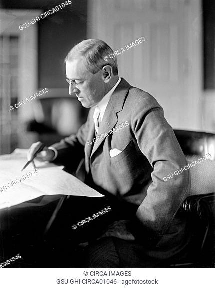 U.S. President Woodrow Wilson Reviewing Paperwork, circa 1910's