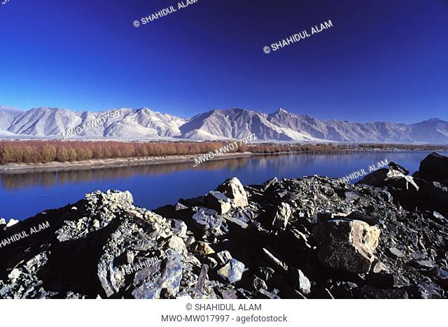 The river Lhasa and the Brahmaputra river locally known as Yarlung Tsang Bo, meet near the Lhasa city Though trees grow next to the river