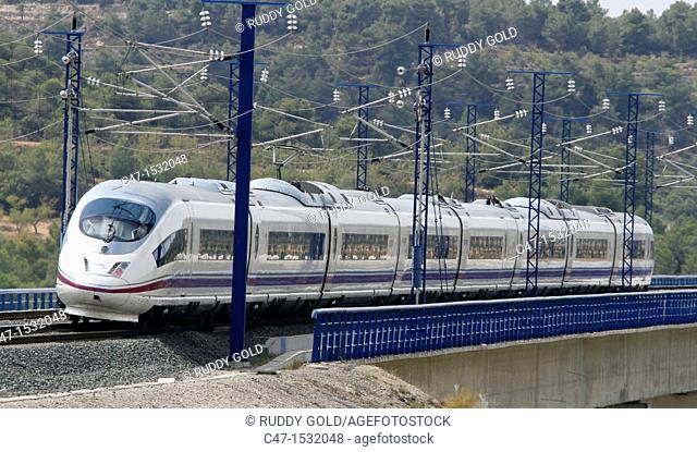 Spain, Catalonia, Lleida province, High Speed Train, AVE Serie 103 passing by the Vinaixa viaduct