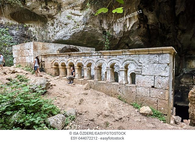 Unidentified people taking selfie at Virgin Mary Church built by St. Paulus inside of cave of Chasm of Heaven in Silifke district. Mersin Turkey