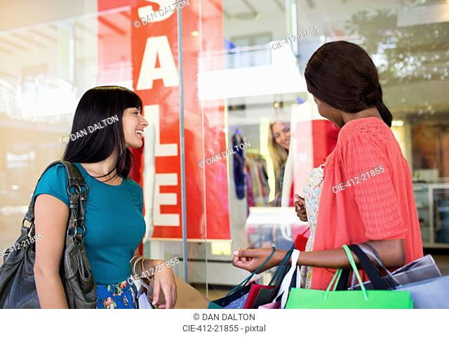 Women window shopping together in shopping mall