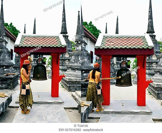 Thai woman knell bell in Wat Phra Mahathat Woramahawihan at Ratchadamnoen Road, Tambon Nai Mueang, Amphoe Mueang, Nakhon Si Thammarat Thailand