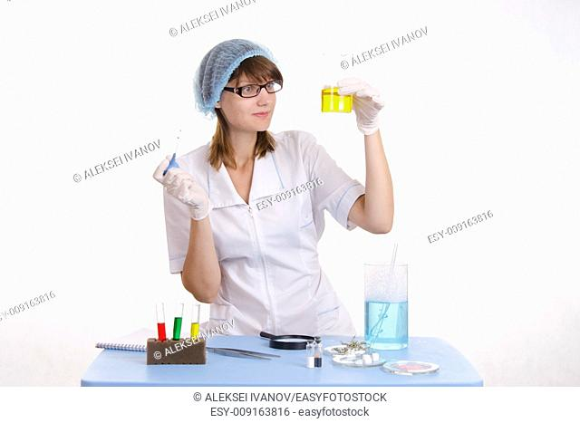 Young beautiful girl posing chemical experiments in the laboratory