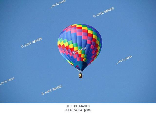 Low angle view of a colorful hot-air balloon against blue sky, Balloon Festival, Albuquerque, New Mexico, USA