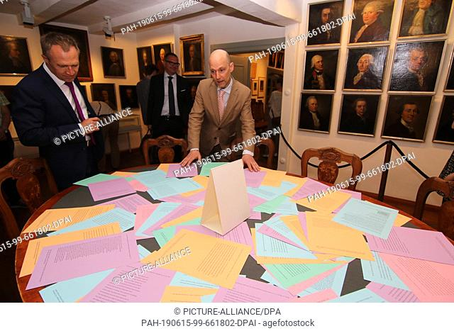 15 June 2019, Saxony-Anhalt, Halberstadt: Visitors to the exhibition look at a table with joke letters. A special exhibition to mark the 300th birthday of the...
