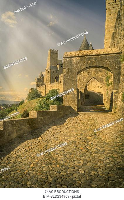 Sunbeams on road to castle in Carcassonne, Languedoc-Roussillon, France