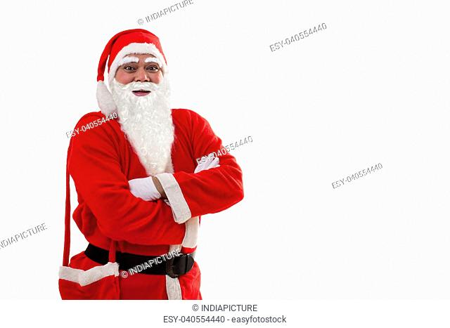 Front view of Santa Claus standing with arms crossed over white background
