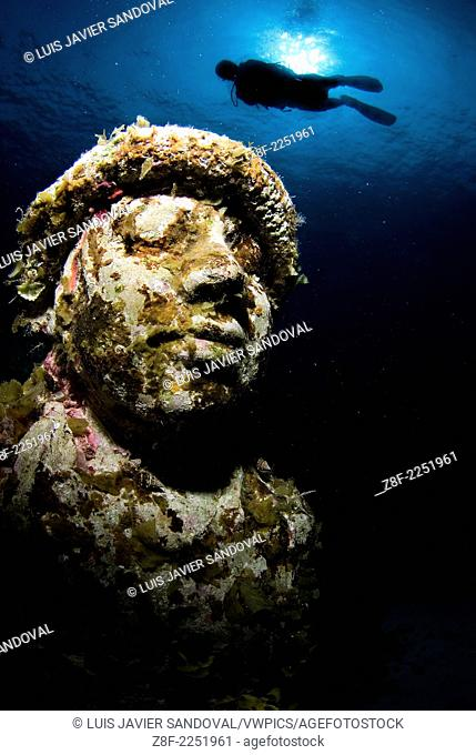 Largest underwater museum located in Cancun Mexico caribbean sea, sculptures made out of real people to drive away tourism from natural reefs and create an...