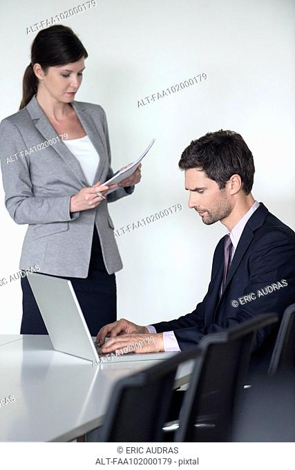 Business associates preparing for meeting