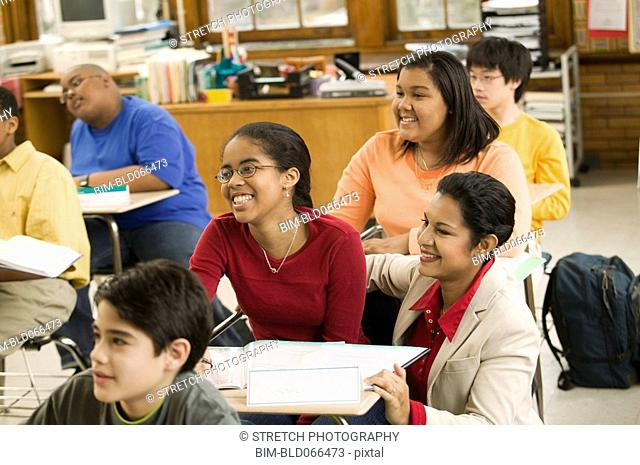 School teacher and students in classroom