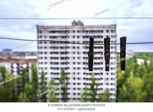 Laundry pins on a balcony of 16-stored block of flats in Pripyat ghost city of Chernobyl Nuclear Power Plant Zone of Alienation in Ukraine