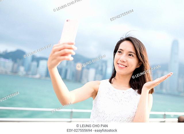 Woman take self image with cellphone