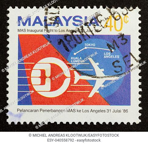 MALAYSIA - 1986: Stamp printed in Malaysia shows a airplane and the route kuala lumpur to los angeles, 1986
