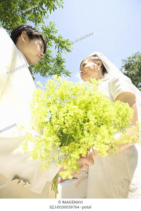 Bridal couple holding a bouquet