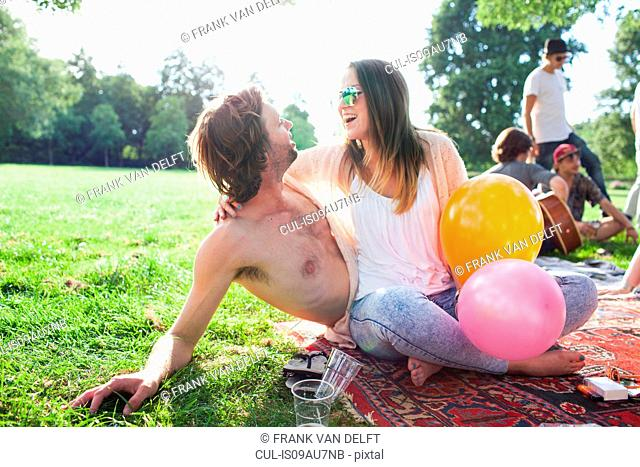 Young couple flirting at park party