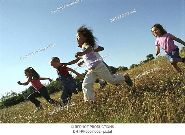 Five children running in field