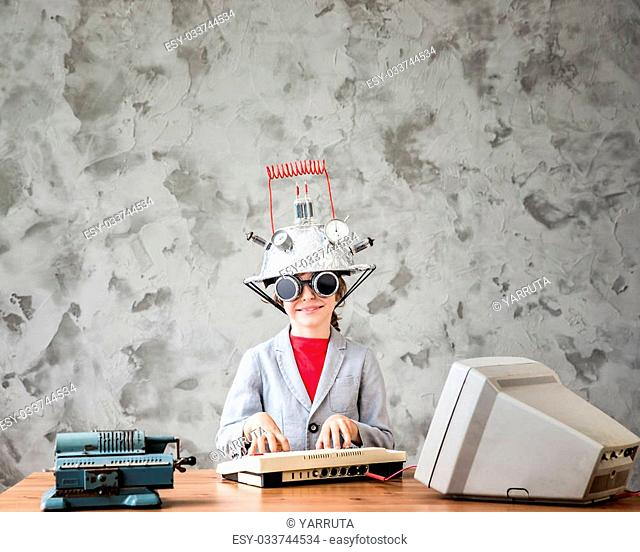 Portrait of young child pretend to be businessman. Kid with toy virtual reality headset in modern loft office. Success, creative and innovation technology...