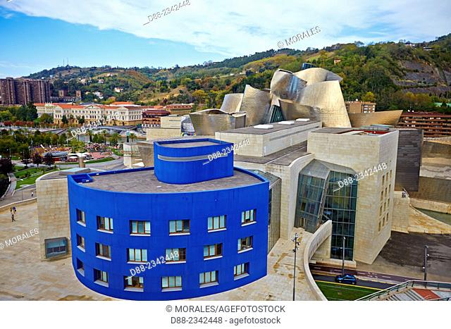 Spain,Biscay,Basque Country Spain,Bilbao,Guggenheim Museum opened in 1997 in the Canadian-American architect Frank Gehry seen from the terrace of Silken Gran...
