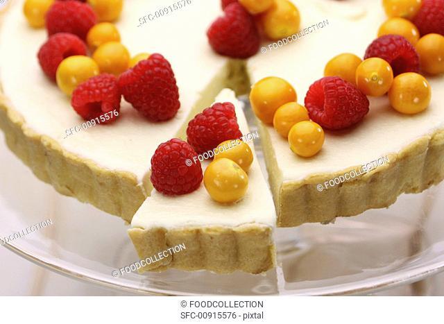 Vanilla tart with cape gooseberries and raspberries