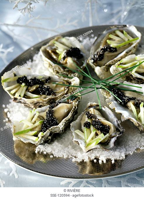 Oysters with caviar and sour apples