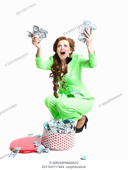 surprised young girl with money in a box on a white background