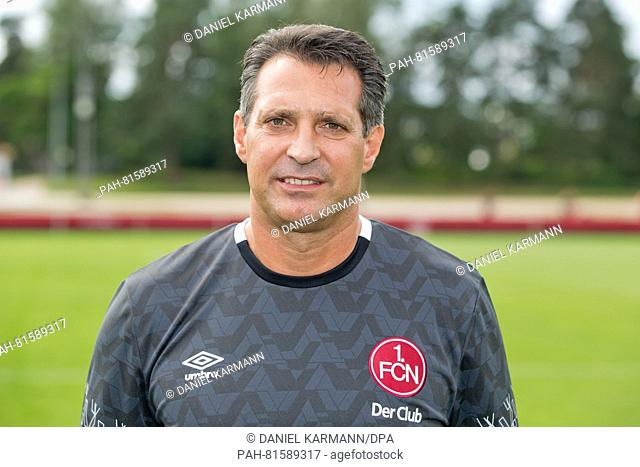 The new head coach of 1. FC Nuernberg, Alois Schwartz (l), pictured at the start of training at Max-Morlock-Platz in Nuremberg, Germany, 27 June 2016