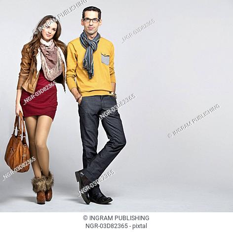 Young sexy couple on white background