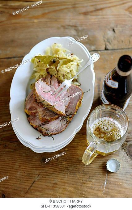 Roast pork with a mustard crust on a bed of sauerkraut