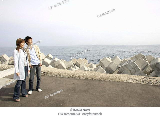 Couple standing at river bank