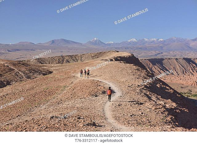 Hiking above Licancabur volcano and the desert landscape in the Moon Valley, San Pedro de Atacama, Chile