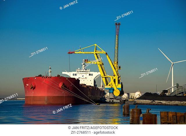 cargo boat unloading coal at Amsterdam harbour