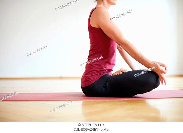 Woman seated in yoga position