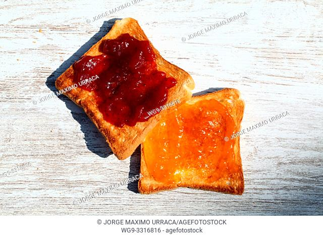 Toast with apricot jam and strawberry with artistic background