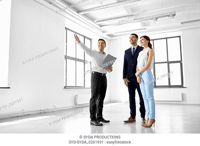 realtor showing new office room to customers