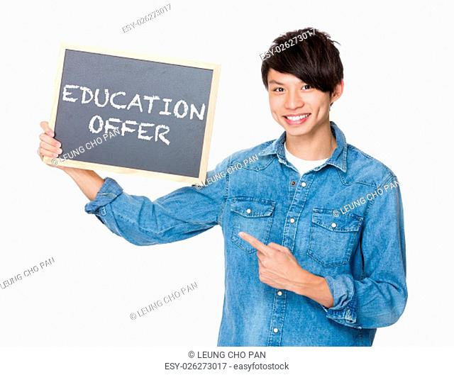 Asian man finger point to chalkboard and showing education offer