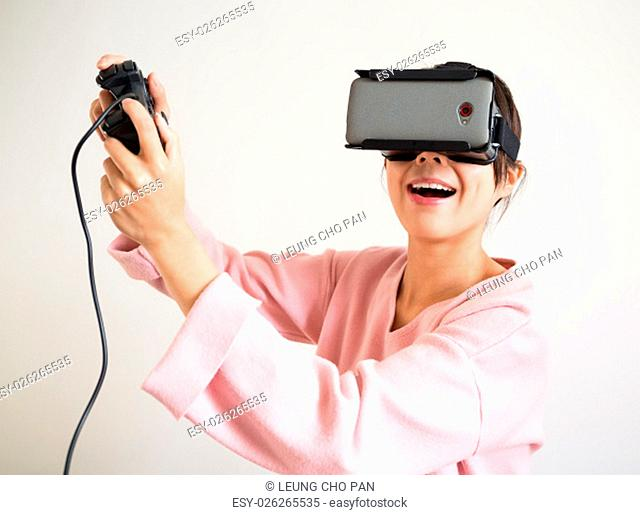 Excite Woman in virtual reality glasses playing the game