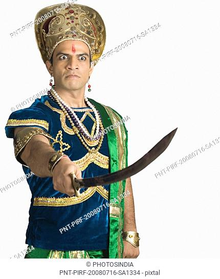 Male character of a Hindu epic holding a sword