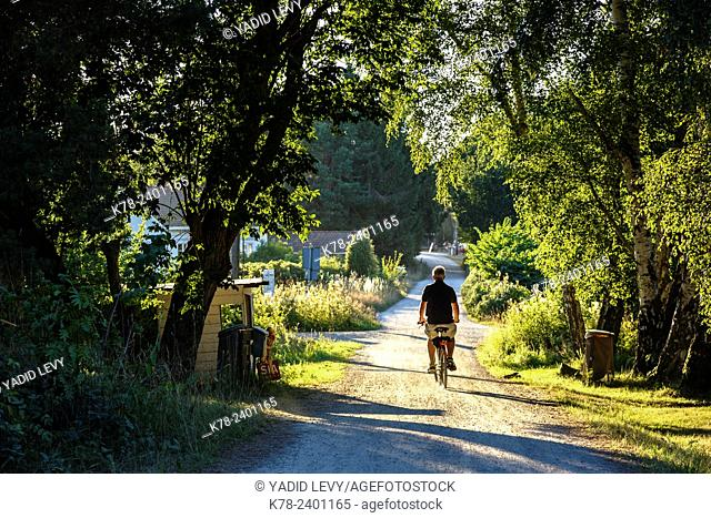 man cycling around Koster Islands, Vastra Gotaland region, Sweden