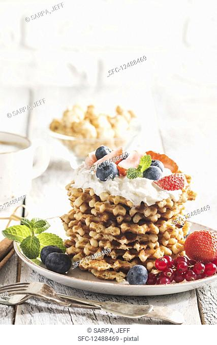 Belgian waffles with cream and fresh berries