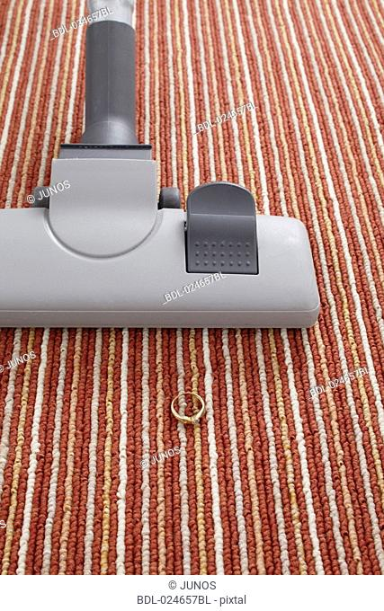 vacuum cleaner accidentally vacuuming ring on carpet