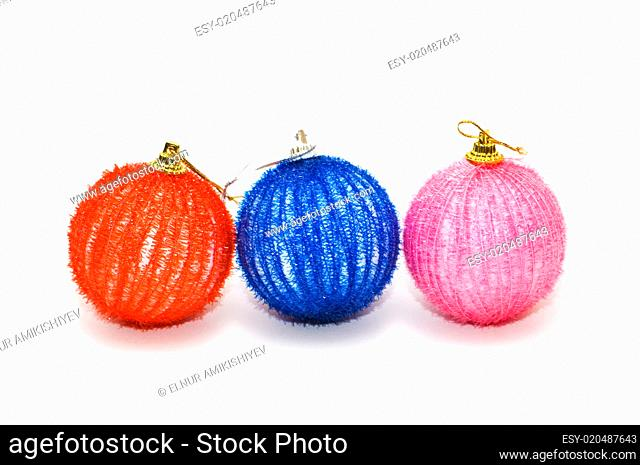 Three christmas balls isolated on the white